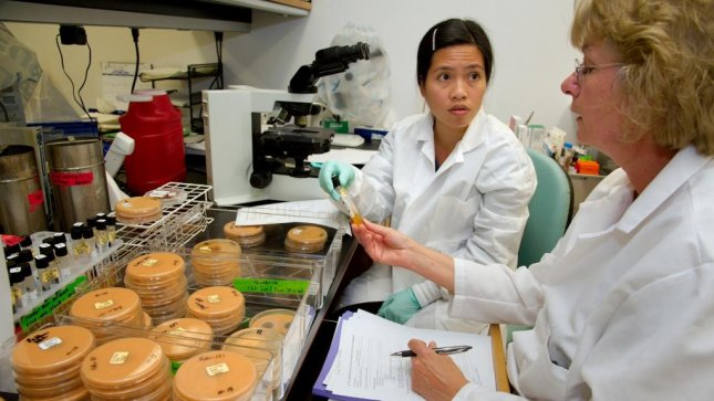 Ngoc Le and Joyce Peterson work to understand the nature of the fungal infection and how best to stop them. (CDC/UPI)