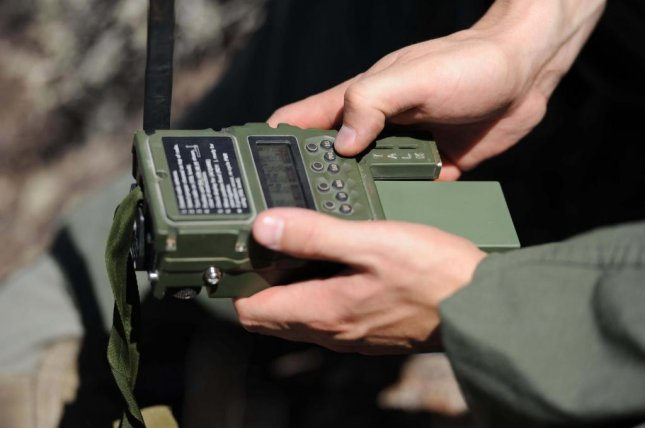 New combat survival radio by General Dynamics - UPI com