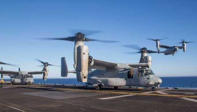 An MV-22B Osprey helicopter of the 26th Marines Expeditionary Unit lands of the flight deck of the USS Bataan. The 26th MEU returned to the United States on Monday after a seven-month forward deployment. Photo courtesy of 26th MEU/Facebook