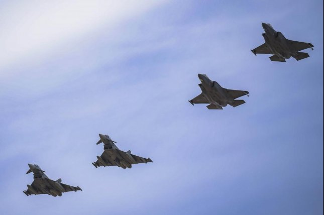 Two F-35A Lightning II joint strike fighters assigned to the 388th Fighter Wing at Hill Air Force Base, Utah, fly in formation with two aircraft belonging to European partners in June 2019. Photo by Evan Parker/U.S. Air Force