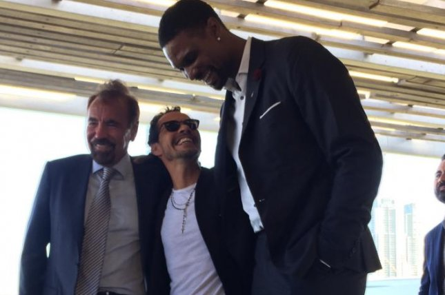 Latin artist Marc Anthony shares a laugh with NBA star Chris Bosh while standing next to Related Group CEO and co-founder Jorge Perez Wednesday at the Perez Art Museum Miami. Anthony will perform on July 29 at the 2017 International Champions Cup presented by Heineken match of El Clásico at Hard Rock Stadium in Miami, Fla. Photo by Alex Butler/UPI