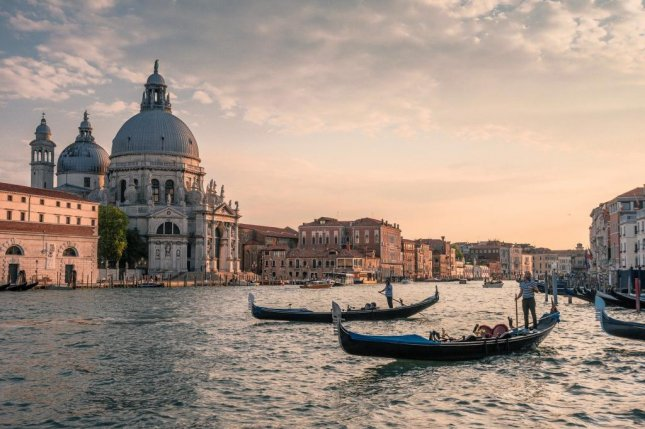 Officials in Venice, Italy, said the maximum capacity of the city's famous gondola boats is being reduced from six passengers to five due to the increasing weight of tourists in recent years. Photo by bogitw/Pixabay.com