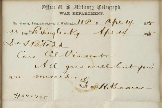 A lock of the 16th U.S. President Abraham Lincoln's hair, wrapped in a telegram stained with his blood, sold at auction Saturday. Photo courtesy RR Auction