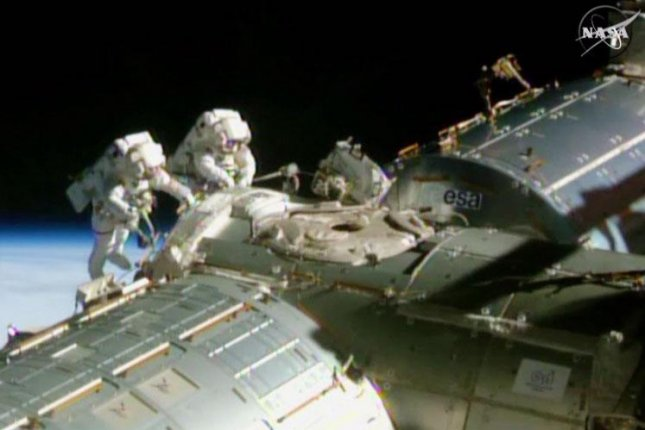 U.S. astronauts make renovations to ISS for space taxis