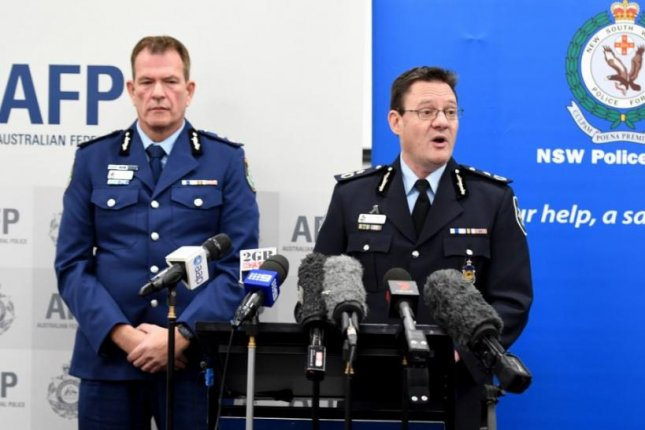 Australian Federal Police Deputy Commissioner Michael Phelan (L) and New South Wales Police Deputy Commissioner David Hudson explain a foiled plot on Friday to bomb a plane departing from Sydney. Photo by Brendan Esposito/EPA