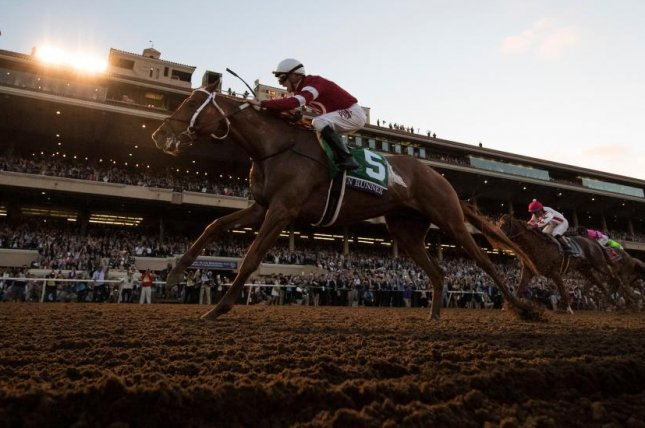 Jockey Florent Geroux celebrates as Gun Runner wins the 2017 Breeders' Cup Classic at Del Mar. Accelerate heads the field for this year's renewal at Churchill Downs of the $6 million race. (Breeders' Cup photo)