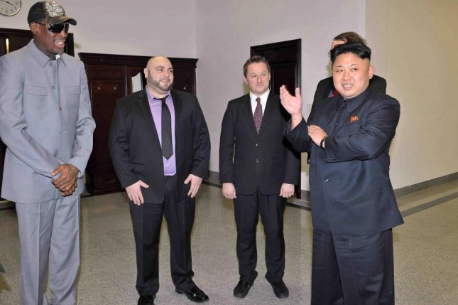 Michael Spavor (C-R), a Canadian citizen arrested in China, has met with North Korean leader Kim Jong Un multiple times. File Photo by KCNA/EPA