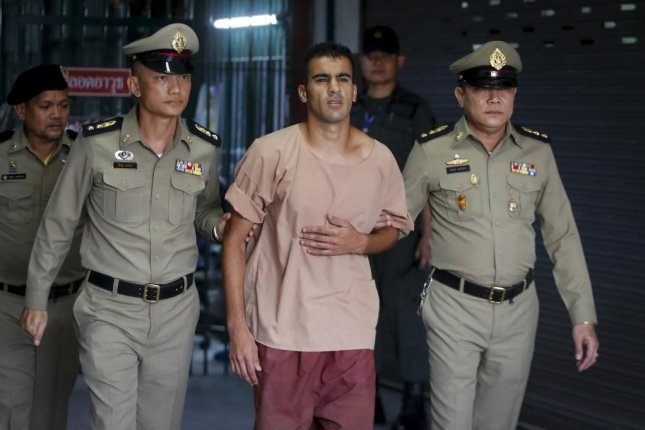 Bahraini soccer player with Australian refugee status Hakeem Al-Araibi (C) walks while escorted by Thai prison officers following an extradition hearing at the Criminal Court in Bangkok, Thailand, in early February. Photo by Diego Azubel/EPA-EFE