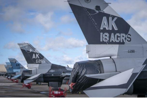 F-16 fighter planes from Eielson Air Force Base, Alaska, line up at Andersen Air Force Base, Guam, in anticipation of Valiant Shield, a 12-day training exercise in Guam and at the Mariana Islands Range Complex. Photo courtesy of U.S. Navy