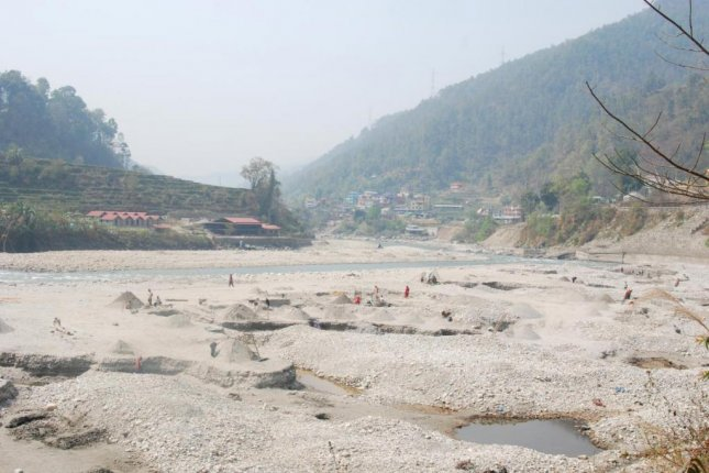 Researchers say that research is needed on the effects of the sand industry -- including sources such as this sand pit in Sunkoshi, near Kathmandu, Nepal -- on the environment, with an eye on sustainability. Photo by Bibek Raj Shrestha