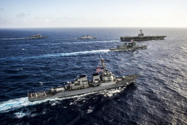 The Malabar military exercises have historically involved the U.S. and India with Japan sitting is an an observer. Japan will now be a permanent participant beginning in 2015. Photo courtesy of the U.S. Navy.