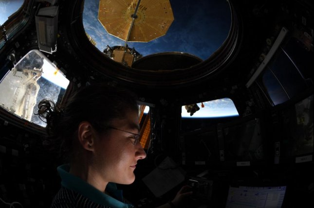 NASA astronaut Christina Koch, shown here in a September aboard the International Space Station, set the record Saturday for the longest space flight by a woman. Photo courtesy of NASA