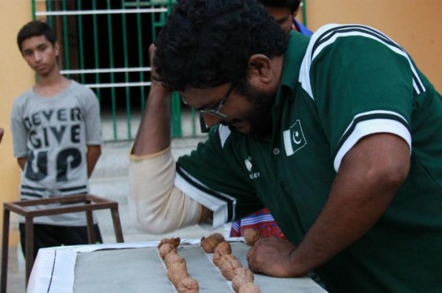 A Pakistani martial artist broke a Guinness World Record when he smashed 256 walnuts with his elbow in one minute. Photo courtesy of Guinness World Records