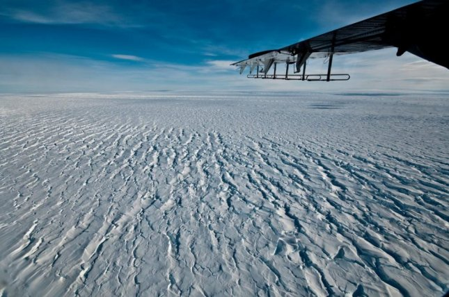 New research suggests the weakening of Pine Island Glacier's ice shelf, which floats atop the Amundsen Sea, caused theinland half of the coastal glacier to speed up by 12 percent. Photo by Ian Joughin/University of Washington