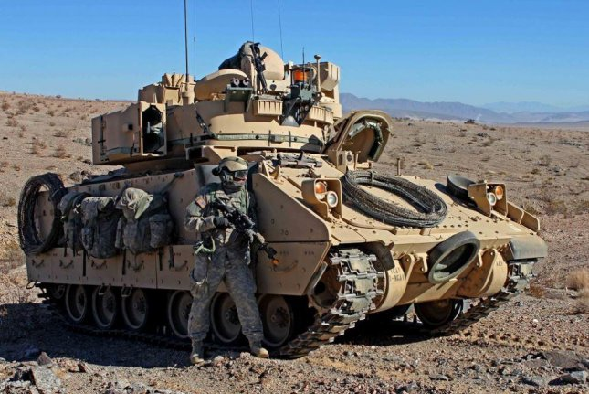 Five companies will share a $299.4 million Defense Department contract for design of the Optionally Manned Fighting Vehicle, to replace the M2 Bradley infantry fighting vehicle, pictured. Photo by Sgt. Eric Garland/U.S. Army