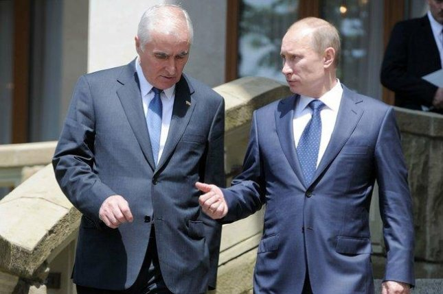 South Ossetia leader Leonid Tibilov, L, and Russian President Vladimir Putin, pictured in 2012. Photo courtesy Russian Presidential Press and Information Office