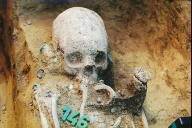 The remains of a girl at a grave site in the 5th century Mözs-Icsei dülő cemetery in Hungary show she belonged to a group of people with non-local origin. Researchers say the group she was a part of arrived in the community about 10 years after it was established. Photo by Wosinsky Mór Museum