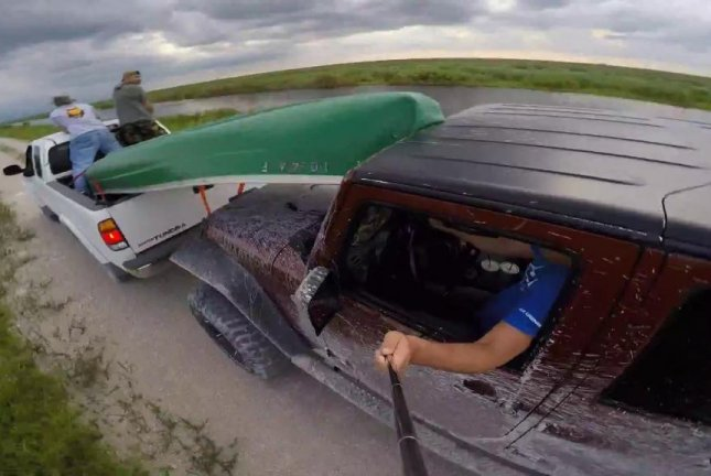 A Jeep driver learns an important lesson about distracted driving while filming himself with a GoPro mounted on a selfie stick. Alex Lopatnyuk/YouTube video screenshot