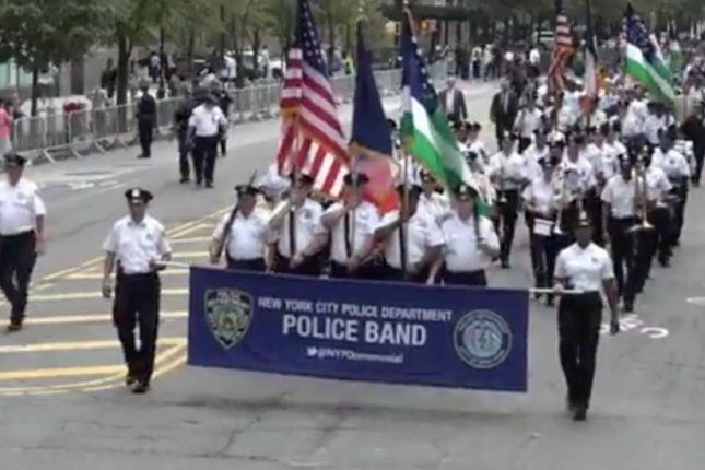 Bands from around the country marched through lower Manhattan Friday in remembrance of those killed in the September 11th attacks. Screenshot from NYPD