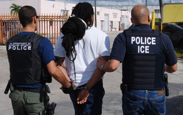 ICE agents arrest a man. On July 31. a U.S. appeals court ruled that a U.S. citizen falsely imprisoned by ICE for three years was not eligible for compensation. File Photo by ICE.gov