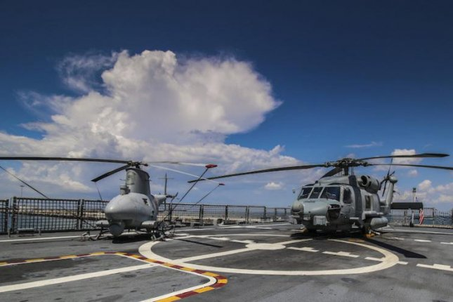 An unmanned MQ-8B (left) together with a MH-60S Seahawk. U.S. Navy photo