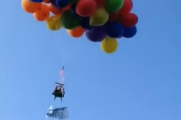 A Canadian man takes flight in a lawn chair attached to more than 100 helium balloons. Screenshot: All Natural Cleaning/YouTube