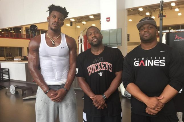 Former Chicago Bulls guard Jimmy Butler with trainer Travelle Gaines, far right. Photo courtesy of Jimmy Butler/Instagram