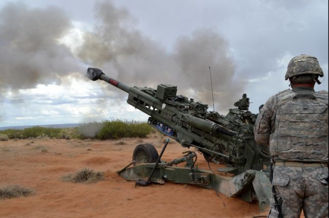 M1156 precision guidance kits are used to turn 155mm artillery shells into smart munitions. Pictured, a M777A2 howitzer fires a 155 mm round equipped with a M1156 Precision Guidance Kit fuze during a live-fire exercise. Photo by Wendy Brown, Fort Bliss Public Affairs Office