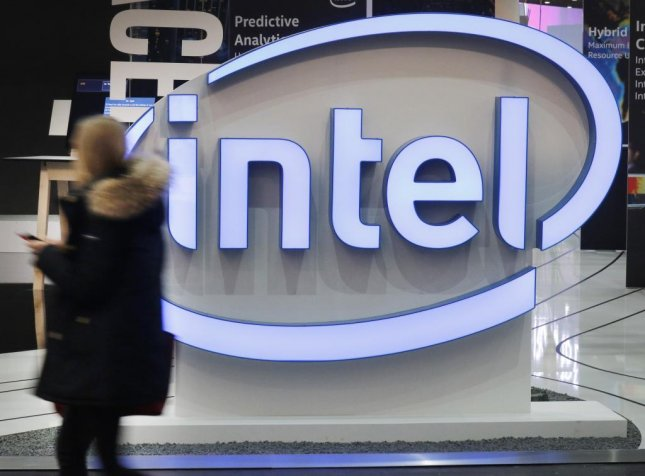 A woman passes an Intel logo at a trade fair in Hanover, northern Germany on March 20. On Wednesday, researchers said Intel chips have two major security flaws. Photo by Focke Strangmann/EPA