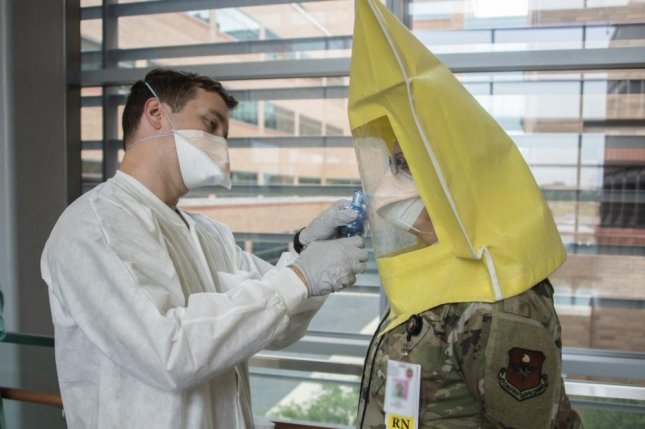 Army 1st Lt. Liston Barber administers an N95 respirator fit test for Air Force 1st Lt. Jennifer Rossi, registered nurse, at Brooke Army Medical Center, Fort Sam Houston, Texas, Friday. The Department of Defense on Tuesday awarded $133 million to three contractors to increase production of the masks. Photo by Jason W. Edwards/U.S. Army