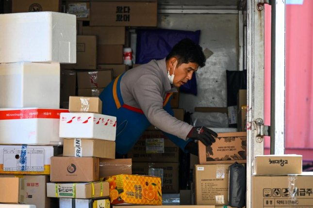 Delivery delivers reached an agreement with employers Thursday to improve grueling working conditions that led to several deaths last year. Photo by Thomas Maresca/UPI