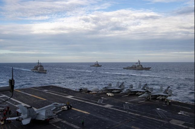 he Theodore Roosevelt Carrier Strike Group transits in formation with the Nimitz Carrier Strike Group in the South China Sea Tuesday. Photo by Deirdre Marsac/U.S. Navy