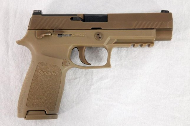 The U.S. Marine Corps will begin replacing its standard issue pistol with the M17 model. Photo courtesy U.S. Army