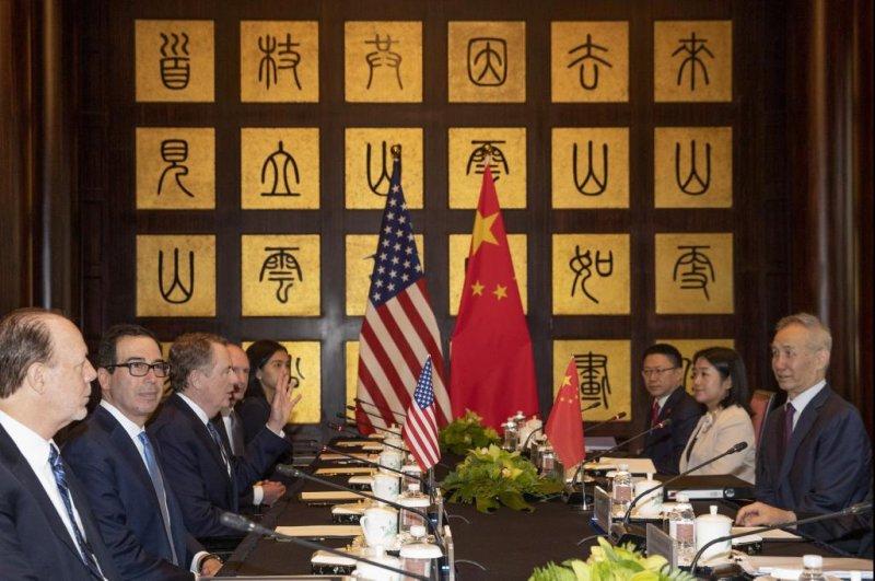 Chinese Vice Premier Liu He (R), U.S. Trade Representative Robert Lighthizer (3-L) and Treasury Secretary Steve Mnuchin (2-L) meet in Shanghai on Wednesday. Photo by Ng Han Guan/EPA-EFE
