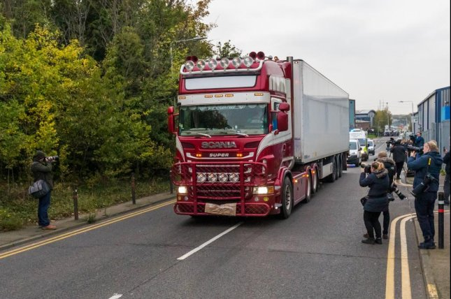 Police drive a truck container from the Waterglade Industrial Park in Essex, Britain, where the bodies of 39 people were found Wednesday. Photo by Vickie Flores/EPA-EFE