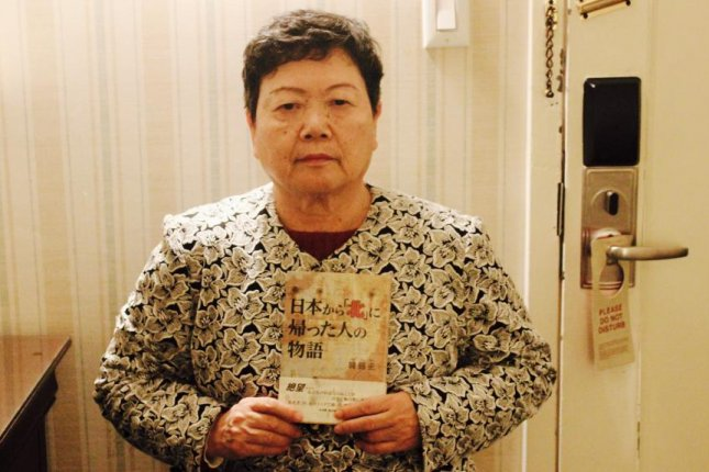 Eiko Kawasaki, a Japanese citizen who was repatriated to North Korea in 1960, holds up her memoir, published in Japan, at a hotel in midtown Manhattan on March 6. Photo by Elizabeth Shim/UPI