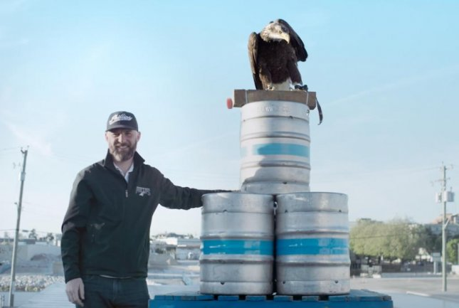 Phillips Brewing & Malting Co. founding brewer Matt Phillips has employed the help of Hercules the bald eagle to deliver a can of the company's newest pilsener to a contest winner. The company teamed up with Pacific Northwest Raptors to coordinate the stunt. 