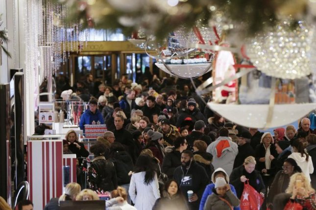 Though shoppers were spending more this holiday season than last, according to the National Retail Federation, a Consumer Confidence Survey released Thursday shows that confidence in the U.S. economy has dwindled in the last two months of the year. Photo by John Angelillo/UPI | License Photo