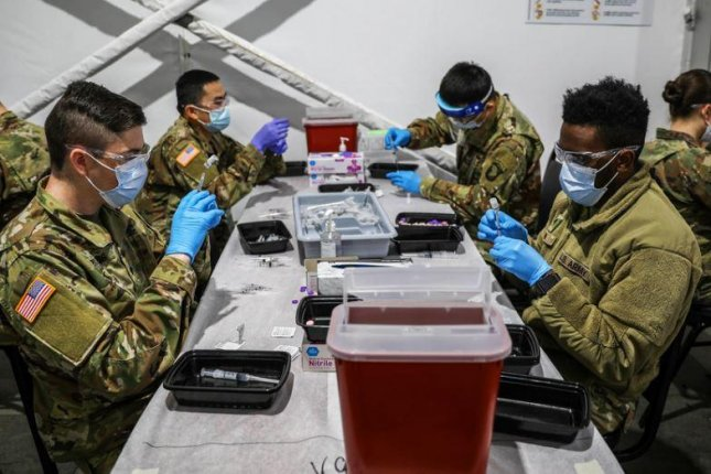 On Tuesday the Defense Department eased travel restrictions between military installations, partially because of the wide availability of COVID-19 vaccines, which U.S. Army Northern Command troops are pictured preparing. Photo by Sgt. Tanis Kilgore/U.S. Army