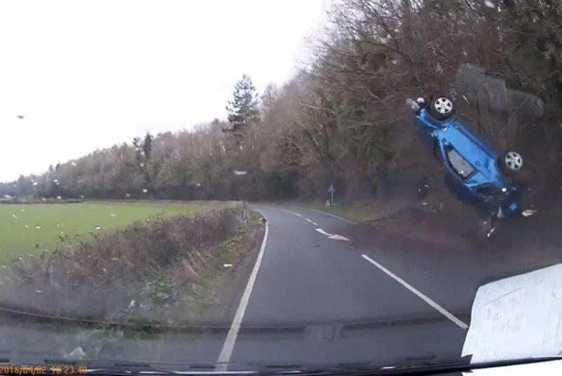 A crashed car flips through the air. Screenshot: Storyful