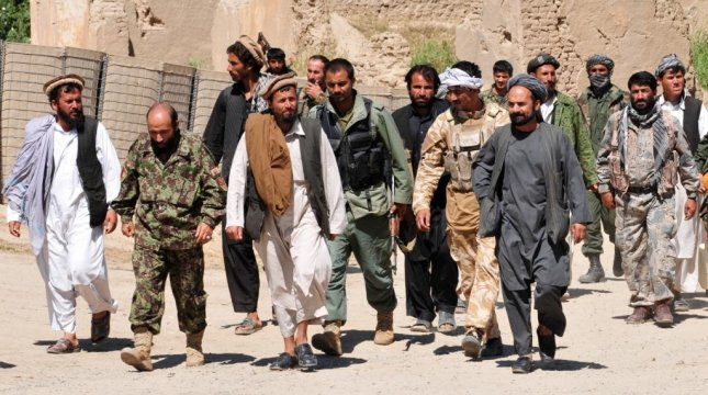 Taliban forces surrender to Afghan National Security Forces. The Taliban established a checkpoint on Afghanistan's Kunduz-Takhar Highway on Tuesday, and kidnapped about 200 people, killing 17. Photo courtesy of International Security Assistance Force/NATO