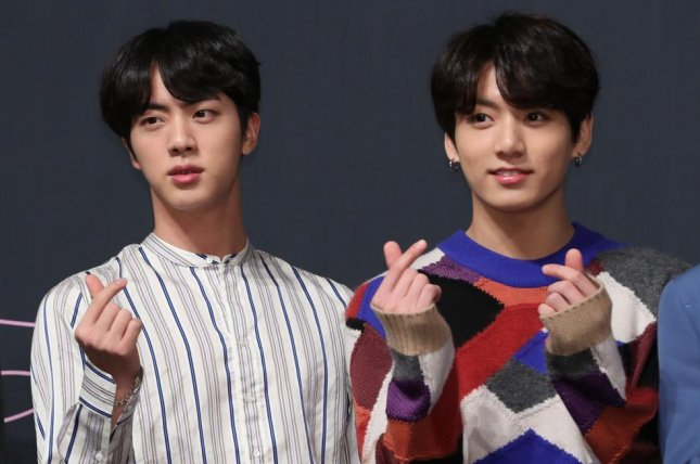 Members of South Korean boy band BTS, including Jin (L) and Jungkook (R), will be featured in videos promoting South Korea in China. File Photo by Yonhap