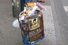 An overflowing garbage bin on the street (CC/Alexander Marks)