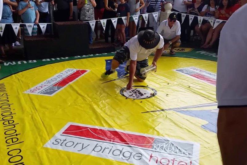 A cockroach race begins at the Story Bridge Hotel in Brisbane, Australia. pauljitterbug/YouTube video screenshot