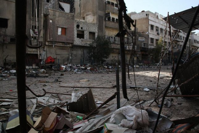 The Yarmouk refugee camp near Damascus, Syria, is now under the control of Islamic State militants. Amnesty International said clashes between IS, Syrian forces and Palestinian groups have led to the deaths of 18 civilians, including a 12-year-old girl. Image courtesy UNRWA