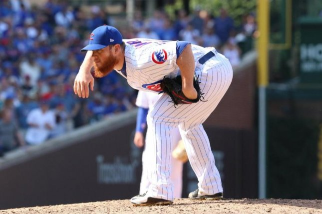 Craig Kimbrel pitched a scoreless ninth inning in his first Cubs save Thursday. Photo by Cubs/Twitter