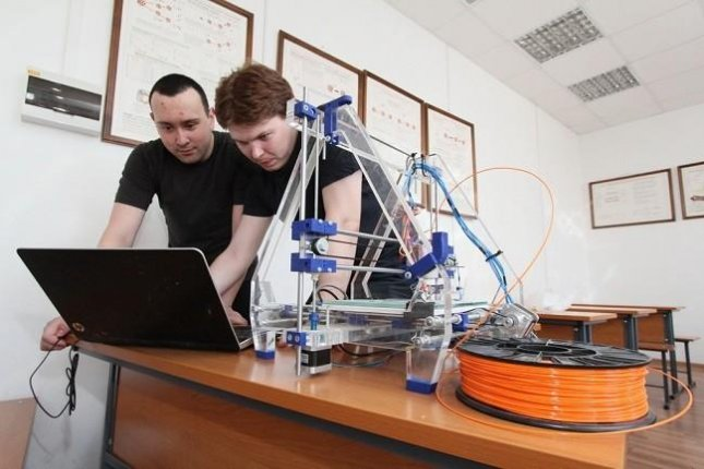 Researchers train the software that powers their prosthetic arm prototype to pick up on the myoelectric signals sent from the brain to muscle to perform motions. Photo courtesy of Tomsk Polytechnic University