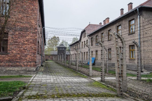 Joseph Hirt, whose family left Poland for Belgrade while fleeing the Nazi, claimed to have escaped the Auschwitz death camp, pictured, by digging a whole and climbing under a fence -- one of several lies he made up in an effort, he said, help preserve the memory of the Nazi's atrocities. Photo by IOsonoTAN/Shutterstock
