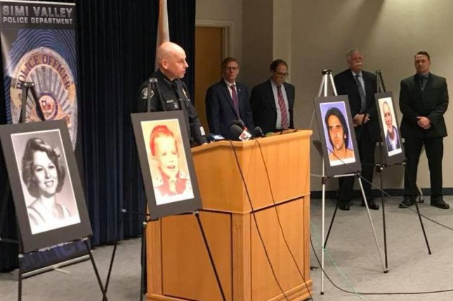 Simi Valley police chief David Livingstone addresses the media on Monday regarding the Craig Coley's clemency request. He appears with photos of the victims, Rhonda Wicht and her son Daniel, and old and current photos of Coley, who was granted a pardon for two murders he didn't commit. Photo courtesy Simi Valley Police Department/Facebook