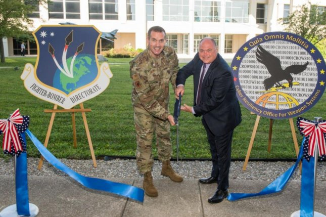 Brig. Gen. Heath Collins, Fighters and Bombers program executive officer, and Joseph Bradley, Cyber Resiliency Office for Weapons Systems director (R), officially opened a cyber defense facility July 9, 2019, at Wright-Patterson Air Force Base, Ohio, Photo by Wesley Farnsworth/U.S. Air Force/UPI